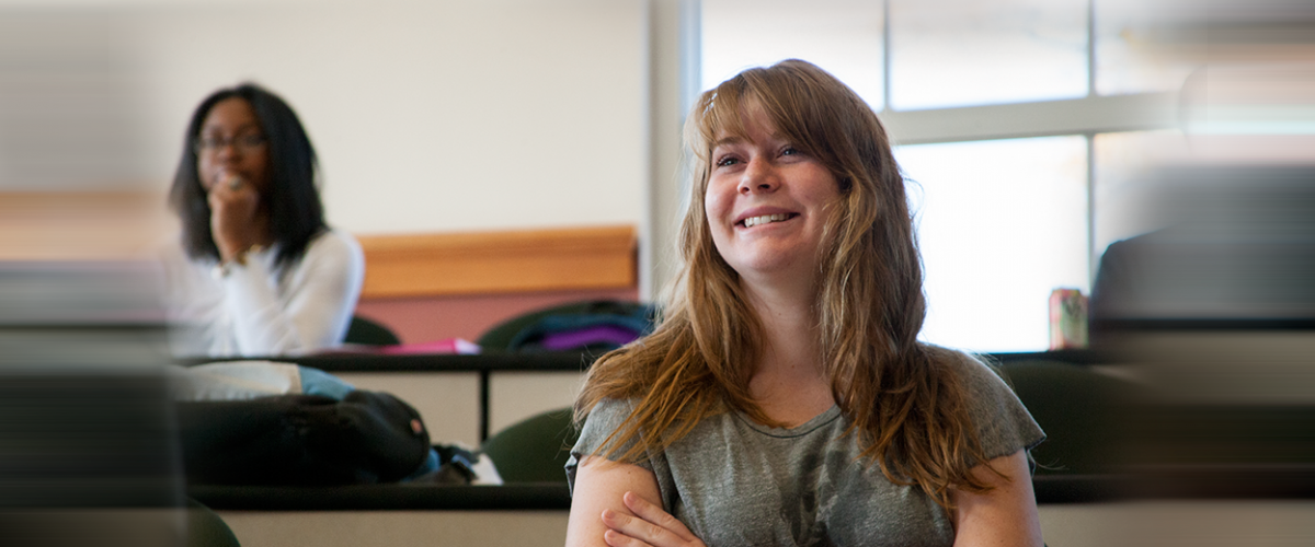 A female student smiles in Daleah Goodwin's class at UGA